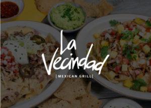 imagen de referencia de comida mexicana como fondo, con el logo del comercio La Vecindad
